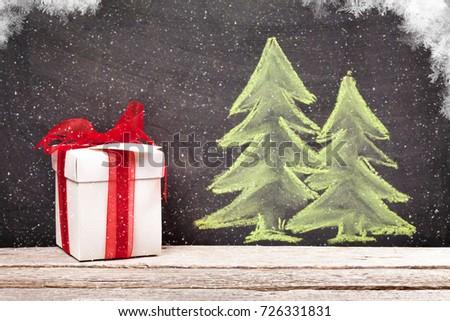 Christmas gift box and hand drawn xmas fir tree with snow #726331831