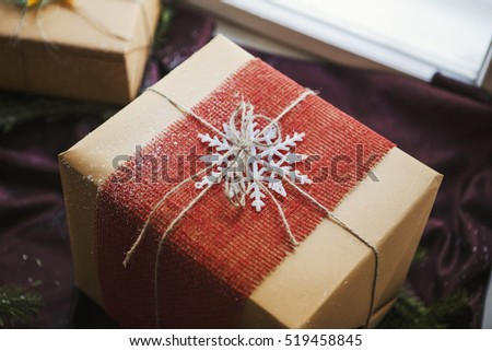 Christmas gift box decorated by snowflake
