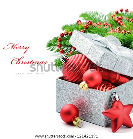 Christmas gift box with festive decorations isolated over white