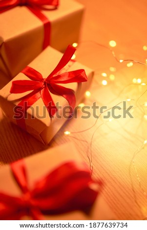 Christmas gift box with festive ribbons and lights