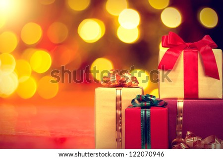 Christmas gift box with lights on background