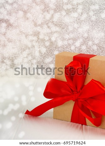 Christmas gift box with red bow and copy space #695719624