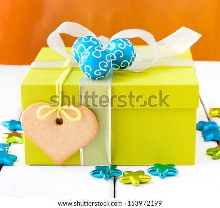 Christmas gift box  with silver bow and  blue bauble cluster. selective focus, shallow dof