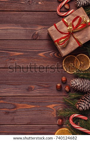 Christmas gift boxes and fir tree  on wooden background. Top view with copy space #740124682