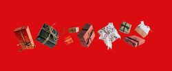 Christmas gift boxes falling or flying in motion on red background. Christmas shopping concept.