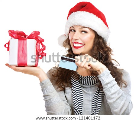 Christmas Gift. Happy Smiling Woman with Gift Box and Credit Card. Sales. Christmas and New Year Gifts. Christmas Shopping. Isolated on White Background