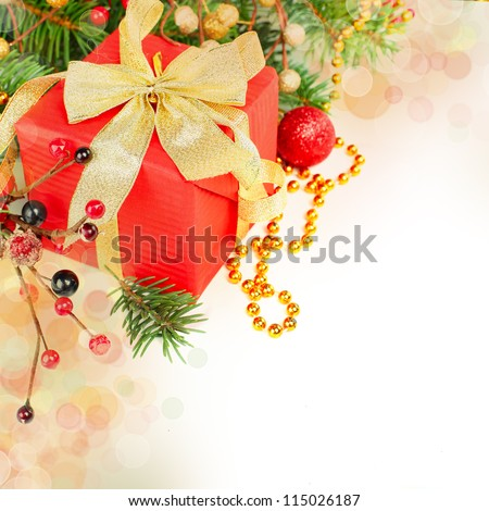 Christmas gift isolated - border with red holly, green fir and gold decor on white background