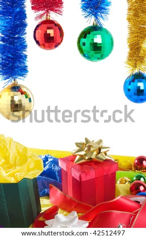 Christmas gift on colorful paper with decoration and toys