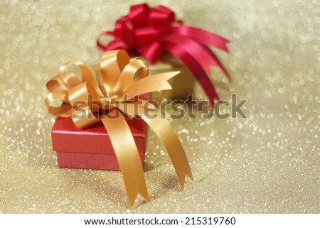 Christmas gift on Decorative background in gold.; #215319760