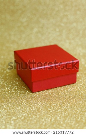 Christmas gift on Decorative background in gold with sparkling stars