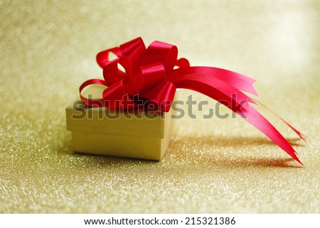 Christmas gift on Decorative background in gold with sparkling stars #215321386