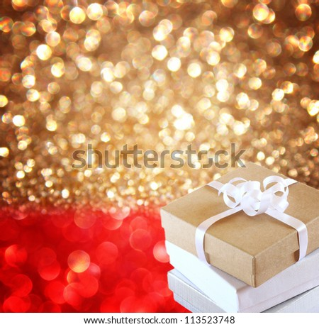 Christmas Gift over red and golden lights background