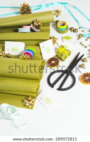 christmas gift packaging with green papers and cards with christmas tree print