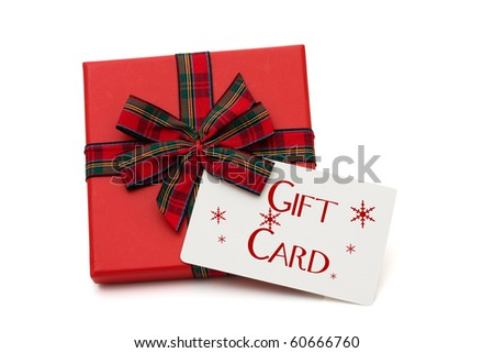 Christmas gift with a gift card isolated on white