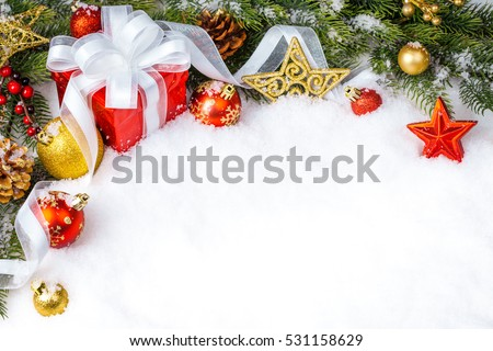 Christmas gift with decoration on white background