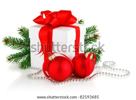 christmas gift with red balls bow and branch fir tree isolated on white background