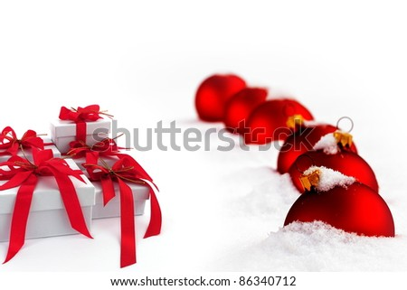 Christmas  gift with red ribbon and red balls