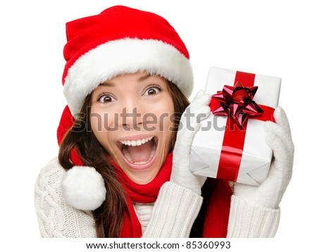 Christmas gift woman isolated. Happy excited santa woman showing christmas prensent isolated on white background.