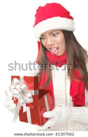 Christmas Gift - woman opening gift disappointed and unhappy, Young woman in Santa hat. Funny cute photo of Asian / Caucasian woman isolated on white background.