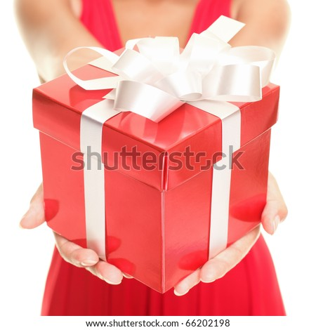 Christmas. Gift woman showing beautiful red gift box - closeup of present on white background.