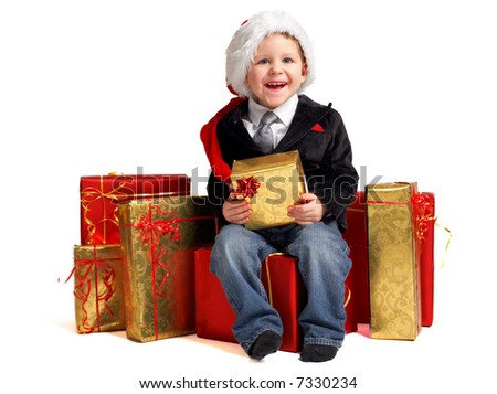 Christmas gifts for little one. Studio shot of happy cute boy in Santa