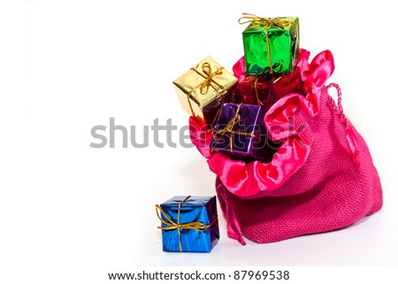 Christmas gifts in colorful packages in the bag