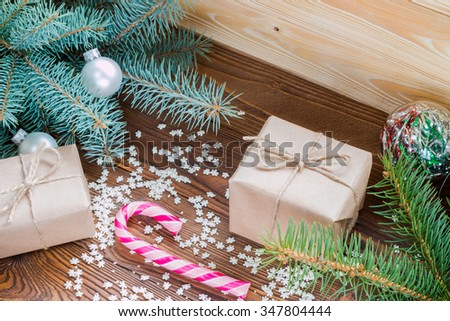 christmas gifts in craft paper, pink candy cane, sprinkling as ...