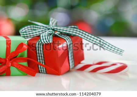 Christmas gifts in front of Christmas tree for the holidays