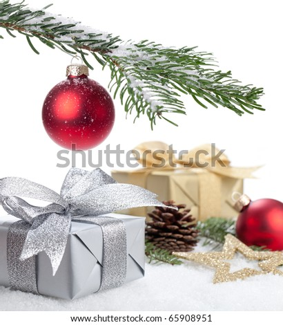 Christmas Gifts lying in snow under a christmas tree