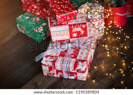 Christmas gifts near traditional decorations #1190389804