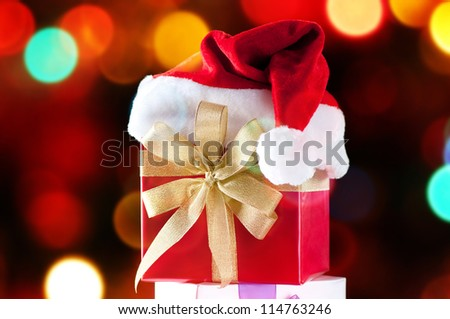 Christmas gifts over defocused glittering lights background