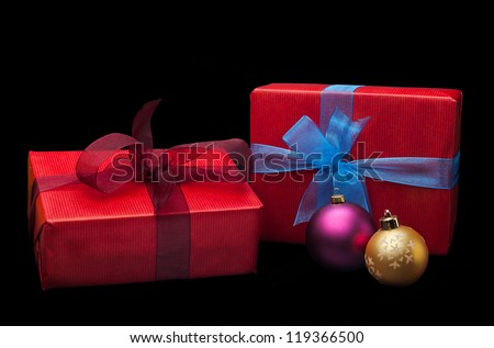 Christmas gifts with balls. Isolated on white background