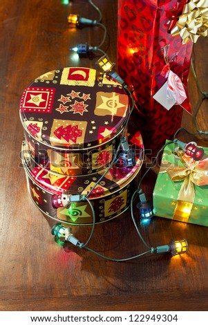 Christmas gifts with Christmas tree lights wrapped around them