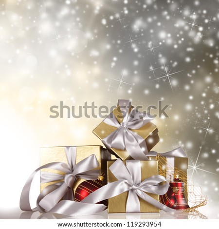 Christmas gifts with falling snowflakes.