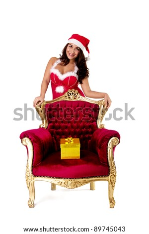 Christmas gifts. Woman with christmas presents wearing santa hat.