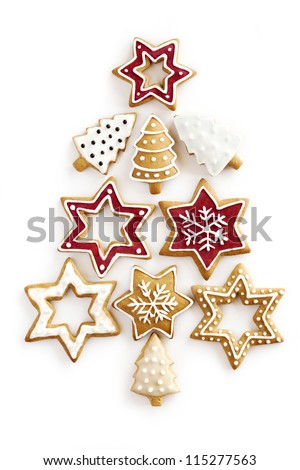 Christmas Ginger and Honey cookies on isolated white background. Star, fir tree, snowflake shape.