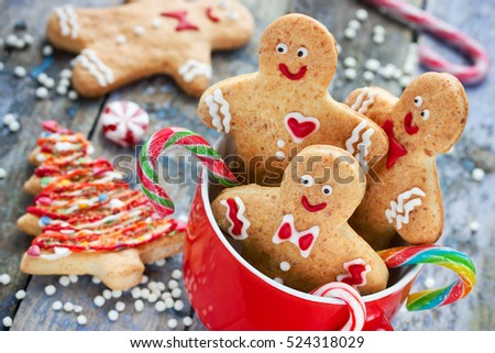 Christmas gingerbread cookies decorated colored icing for new year day, christmas party, winter holiday, sweet homemade gift for kids