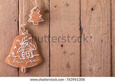 Christmas gingerbread hanging over rustic wooden background. Christmas and New Year concept #763961308