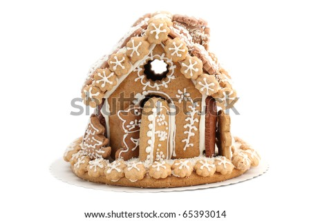Christmas gingerbread house isolated on white background. Shallow dof