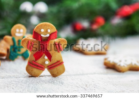Christmas gingerbread  men cookies on white wooden board with copy space