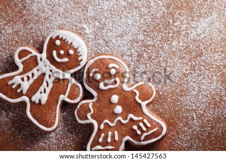 Christmas gingerbread men on sugar background with copy space