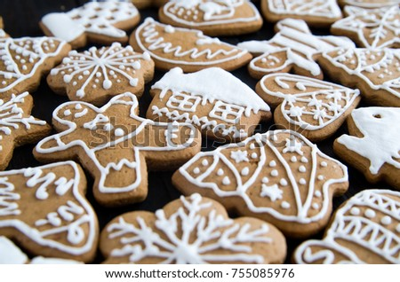 Christmas gingerbread of different kinds on a black wooden background and on a blue wooden background #755085976