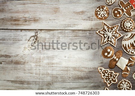 Christmas gingerbread on a light wooden table. A Symbol Of Christmas. Festive food. Delicious cookies and gingerbread. The gingerbread man. Table decoration for the holiday. #748726303