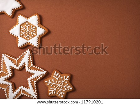 Christmas gingerbread stars on brown paper background. Top view