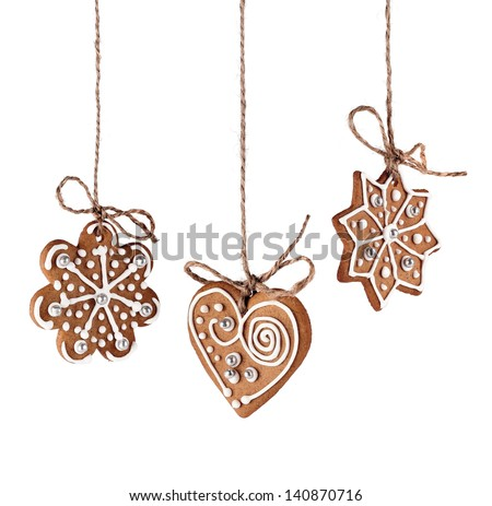 Christmas gingerbreads hanging in traditional linen string isolated