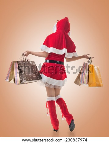 Christmas girl holding shopping bags, rear view portrait isolated. #230837974