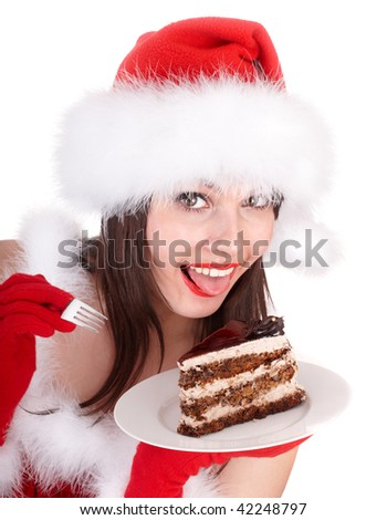 Christmas girl in red santa hat and cake on plate. Isolated.