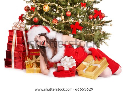 Christmas girl in santa hat holding red gift box. Isolated.