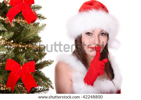 Christmas girl in santa hat with fir tree. Isolated.
