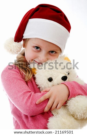 Christmas girl in Santa hat with toy bear